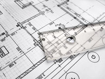 Straightedge on architectral drawing. On the table Stock Photos