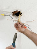 Straightening Electric Wires Royalty Free Stock Photo