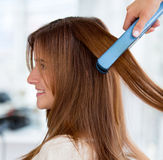 Straightening hair Royalty Free Stock Photography