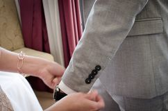 Straightening sleeves. On the groom before ceremony Royalty Free Stock Images