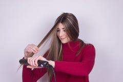 straightner de fille de probelem de cheveux Photo stock