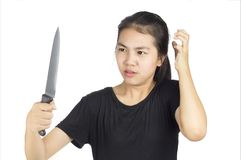 Strain. Woman strain hand holding knife white backgrounf royalty free stock photo
