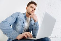 Serious young man taking decision royalty free stock photography