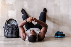Strained african bearded sportsman finishing exercie Stock Images