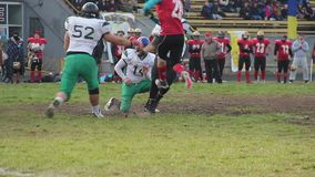 Strained attack on scrimmage line, winners celebrating success, gridiron match