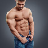 Strained chest and abs. Royalty Free Stock Photography