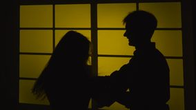 Strained relationship. Quarrel with a slap. Silhouette. Slow motion. Close up stock video