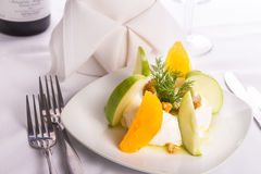 Strained Yogurt Labneh Citrus Salad Garnished with Dill and Waln. Strained yogurt labneh citrus salad with peeled oranges and green apples garnished with dill Stock Photo