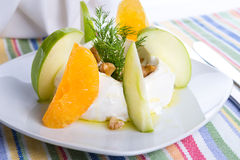Strained Yogurt Labneh Citrus Salad Garnished with Dill and Waln. Strained yogurt labneh citrus salad with peeled oranges and green apples garnished with dill Royalty Free Stock Photos