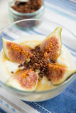 Strained yogurt with sliced figs and honey Royalty Free Stock Image