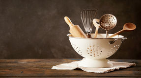 Strainer full of kitchen utensils Royalty Free Stock Images