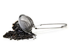 Strainer with tea leafs Stock Image