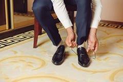 Straining Laces on Black Shoes Stock Photo