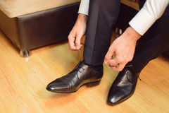 Straining Laces on Shoes Stock Images