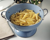 Straining the pasta Royalty Free Stock Photo