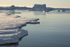 Strait between the Antarctic islands covered with ice. Royalty Free Stock Images
