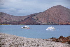 Strait between Bartolome and Santiago islands with anchored yachts Royalty Free Stock Image
