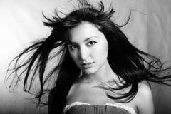 Strait look of model in studio. Black and white. Black and white photo of beautiful model in studio Stock Photo