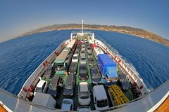 Cars On Ferry Boat Strait Of Messina, Italy. STRAIT OF MESSINA, ITALY - JULY 13, 2016: top view cars ferry boat on Strait of Messina, from the town of Messina to royalty free stock photo