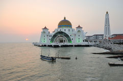 Strait mosque during sunset Stock Photo