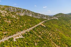 Strait road through the macchia landscape Royalty Free Stock Photo