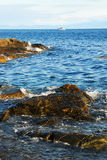 Strait and rocky sea shore Stock Images