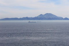 Straits of Gibraltar and Atlas Mountains. Busy maritime traffic in the Straits of Gibraltar and Atlas Mountains Royalty Free Stock Photo