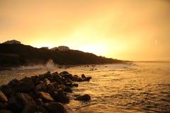 strand över solnedgång Arkivfoto