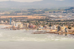 The Strand as seen  across the sea. CAPE TOWN, SOUTH AFRICA - DECEMBER 20, 2014: The Strand  and Somerset West as seen across the sea from the viewpoint at the Royalty Free Stock Photography