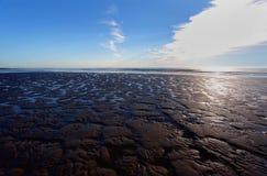 Strand bei Ebbe Stockbild