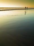 Strand bij zonsondergang Stock Afbeelding