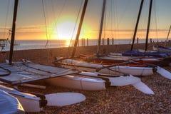 strand brighton över solnedgång Royaltyfri Bild