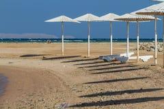 Strand an der Dämmerung Lizenzfreie Stockbilder