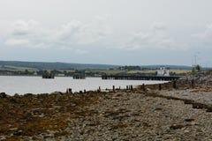 Strand en Pijler in Invergordon Stock Fotografie