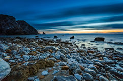 Strand en zonsonderganghemel Stock Fotografie
