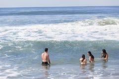 Strand för flickapojkesimning Fotografering för Bildbyråer