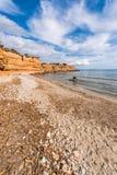 Strand för Sa Caleta i Ibiza Arkivbilder