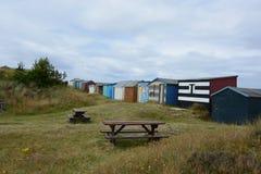 Strand-Hütten durch Hopeman-Strand Stockbilder