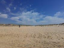 Strand, himmel och vatten Arkivbild