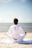 Strand-Meditation Stockfoto