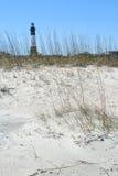 Strand met vuurtoren Stock Foto