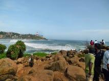 Strand mit Leuchtturm Lizenzfreie Stockbilder