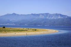 Strand mit Sand stockbild