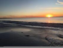 Strand och solnedgånghimmel Arkivbilder