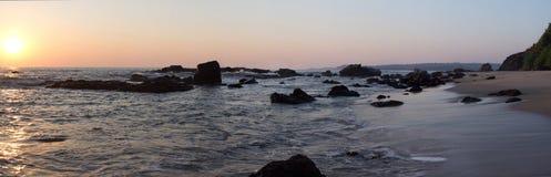 Strand och solnedgånghimmel Arkivbild