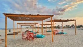 Strand op zonsondergang Stock Foto's