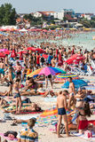 Strand Overvol met Mensen Royalty-vrije Stock Foto