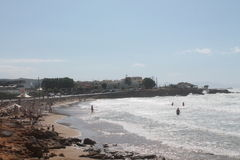 Strand, overzees en mensen het zwemmen Stock Afbeeldingen
