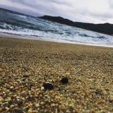 Strand-overzees-golven stock foto