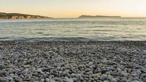 Strand på skymningen Arkivfoton